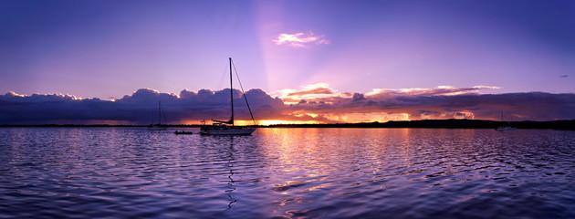 Blue, mauve coloured stratocumulus cloudy nautical coastal Sunset Seascape.