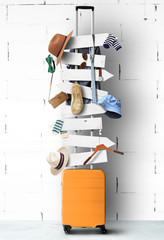 Travel suitcase with wooden signs and hanging clothes and accessories