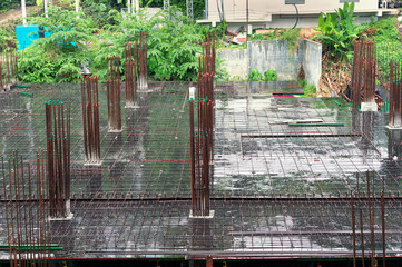 Aerial view of  construction site ..Steel foundation of high rise building in rainy day ,no worker.