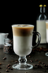 Photo Blinds Coffee beans Ice latte or Iced coffee with milk and ice cubes in a glass beaker against a dark background. refreshing drink. summer drink.