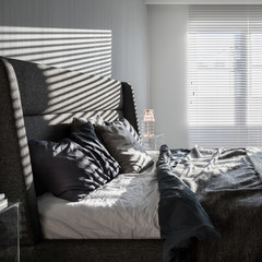 Gray bedroom with window blinds