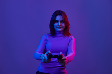 Serious female playing video games