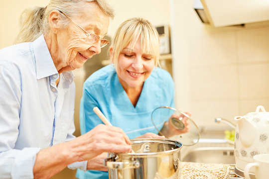 Nursing wife and senior citizen while cooking