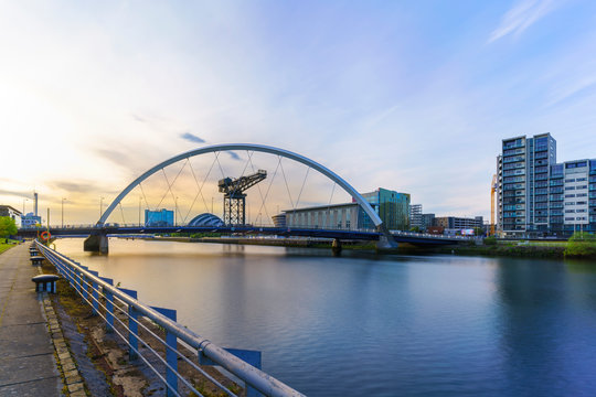 The Clyde Arc Bridge or the Squinty Bridge crossing the river Clyde in twilight in Glasgow , Scotland , UK
