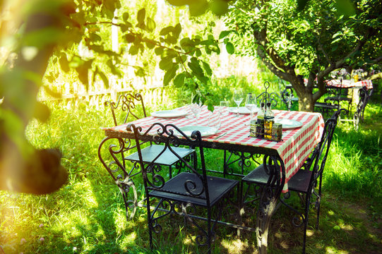 Table is set and waiting for dining in the countryside
