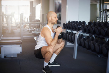 Shot of man in the gym doing dumbbell exercises