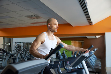 Man doing cardio training on treadmill