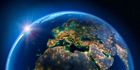Planet Earth at night with the rising sun with the light of cities illuminating a detailed exaggerated relief. Europe. 3D rendering. Elements of this image furnished by NASA