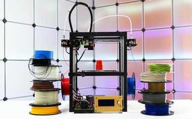 Fototapeta 3d printer and plastic filament on color background obraz
