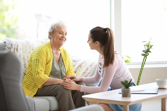Caregiver with senior woman in nursing home