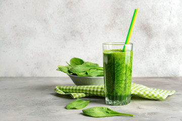 Glass of fresh smoothie on grey table