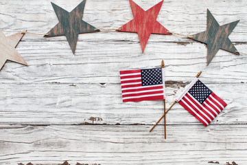 Fourth of July Background. Wooden stars with American flags over a white rustic background to celebrate America's Independence Day.