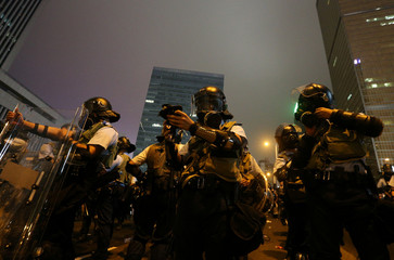 Riot police prepare their gear during a demonstration against a proposed extradition bill in Hong Kong