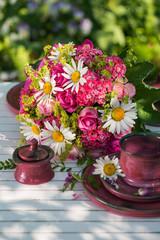 Summer flower arrangement with pink roses