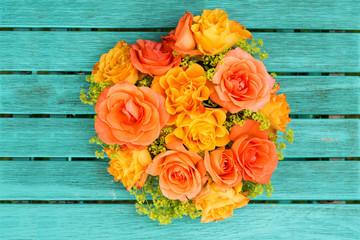 Roses flower heart on wodden background