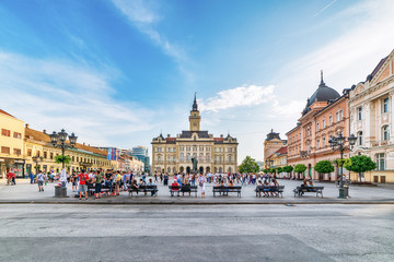Novi Sad, Serbia June 11, 2019:  Freedom Square (serbian: Trg slobode) is the main square in Novi Sad. The photo shows County government office (City house) and monument of Svetozar Miletic.