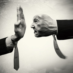 Conflict between the two people, business competition, raiding. Concept of stop aggression. Image