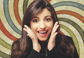Portrait of a surprised young woman on a vintage background
