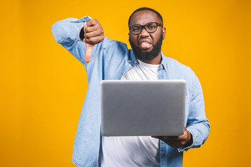 People and tiredness concept. Fatigue black African American man takes off spectacles, feels sleepy and overworked, surrounded with modern technologies. Wall mural