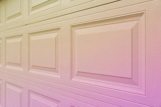 Pinkish purple to yellow gradient garage door paneling.