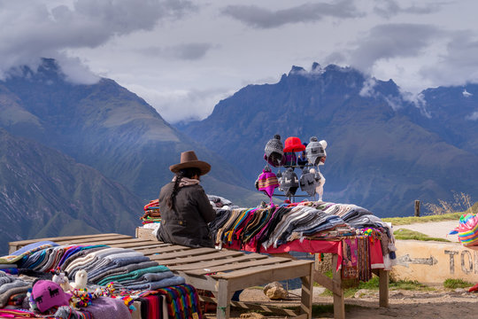 Peruvian women selling colorful hats and scarfs on the scenic and popular viewpoint.