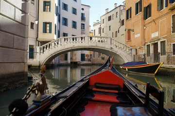First person view from the venetian gondola while traveling around on the water, Venice, Italy