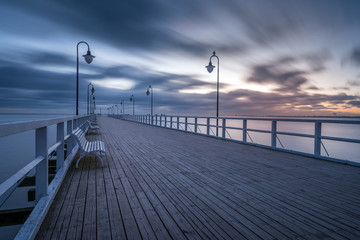 Wooden pier in Gdynia Orlowo. Early morning on the Baltic Sea. Poland, Europe.