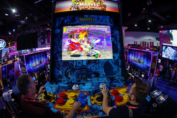Attendees play a video game at E3, the annual video games expo experience the latest in gaming software and hardware in Los Angeles