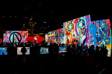 Gamers play video games at E3, the annual video games expo experience the latest in gaming software and hardware in Los Angeles