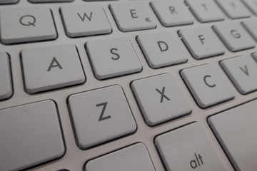 Close-up detail of a QWERTY keyboard of a laptop PC
