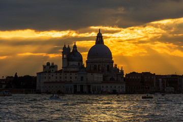 Beautiful Salute Basilica (Saint Mary of Helath) old domes at sunset in Venice