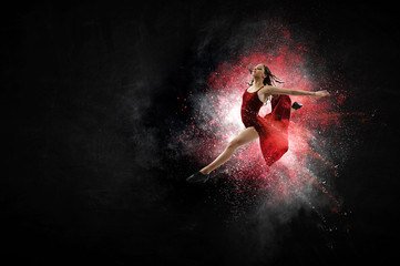 Young and beautiful female dancer in a red dress. Mixed media