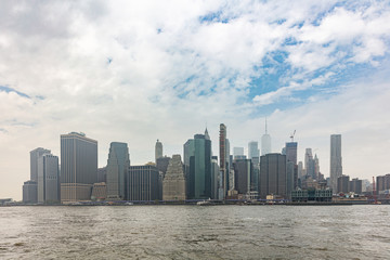 Wall Mural - Manhattan skyscrapers, New York city skyline, cloudy spring day