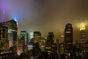 Fototapete - Aerial view of Manhattan illuminated skyscrapers, New York city at night