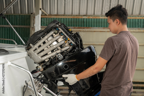 Repairing engines on aluminum boats , The technician is