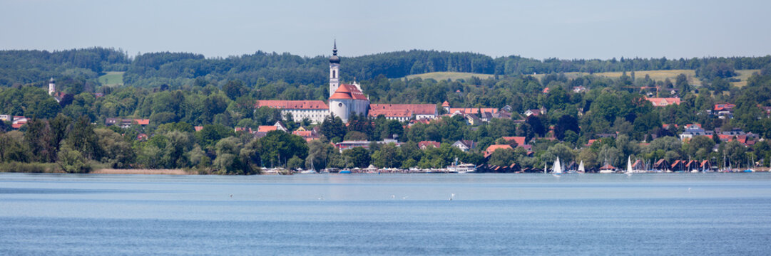 Panorama view of the Marienmünster Dießen (abbey church). In the foreground Lake Ammersee. Fantastic landscape of Upper Bavaria. Great travel destination.
