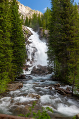 Streaming Waterfall with white water and rocks in Montana.