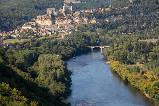The medieval Chateau de Beynac rising on a limestone cliff above the Dordogne River seen from Castelnaud. France, Dordogne department, Beynac-et-Cazenac