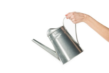 cropped view of girl holding watering can isolated on white