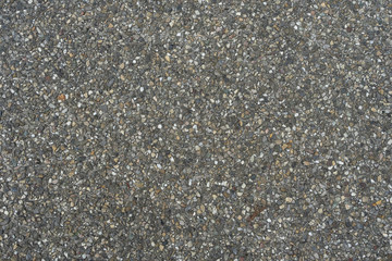 tar asphalt road texture with small pieces of rock pebble texture pattern