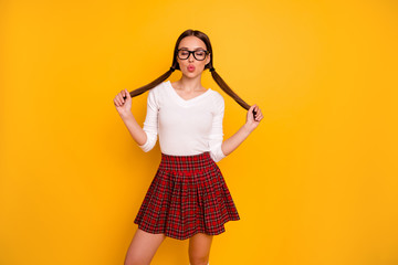 Portrait of charming attractive lady youth people touch hairdo haircut close eyes eyewear eyeglasses smart person want date send air kisses isolated modern clothing yellow background