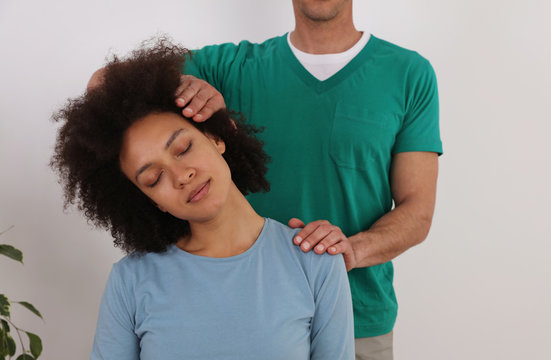 Woman having chiropractic back adjustment in rehabilitation clinic. Osteopathy, Physiotherapy concept