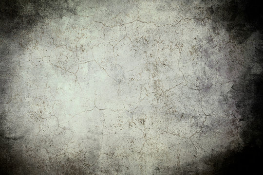 Old wall grungy background or texture with dark vignette borders