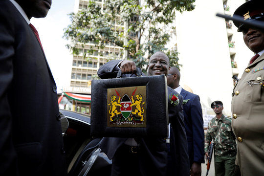 Kenya's Cabinet Secretary of National Treasury Henry Rotich holds up a briefcase containing the Government Budget for the 2019/20 fiscal year in Nairobi