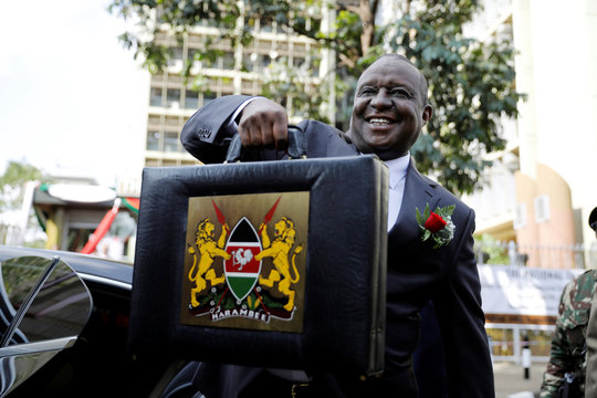 Kenya's Cabinet Secretary for National Treasury Henry Rotich holds up a briefcase containing the Government Budget for the 2019/20 fiscal year in Nairobi