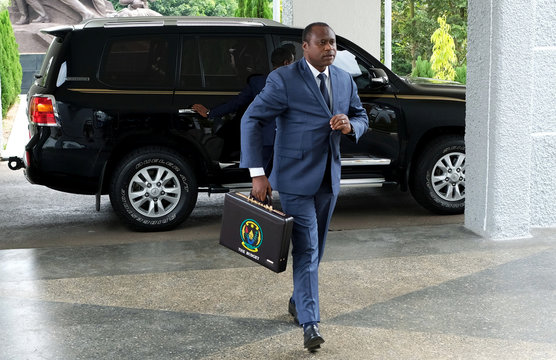 Rwandan finance and economic planning minister Uzziel Ndagijimana carries a briefcase containing the Government Budget documents for the 2019/20 fiscal year in Kigali