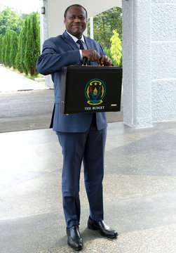 Rwandan finance and economic planning minister Uzziel Ndagijimana holds a briefcase containing the Government Budget documents for the 2019/20 fiscal year in Kigali