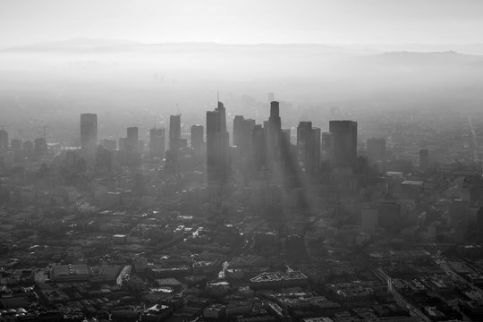 Aerial black and white view of thick summer smog in urban downtown Los Angeles, California.