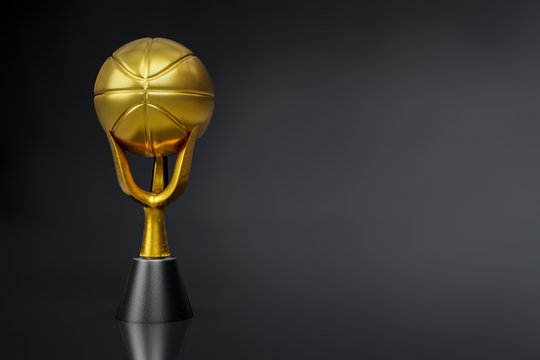 3d rendering of the basketball golden trophy on dark background studio shot with clipping paths.