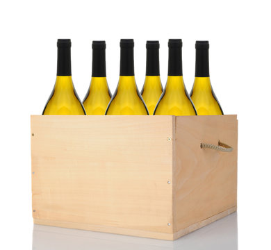 Six Chardonnay Wine Bottles in a Wood Crate over white